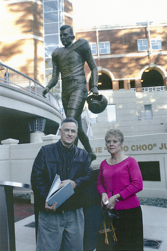 Johnpaul Harris and Barbara (Justice) Crews, daughter of Charlie Justice, pose during dedication day for the Charlie Justice statue, November 5, 2004.