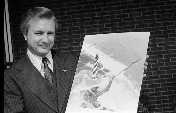 Governor Hunt holding aerial photograph of Cape Hatteras Lighthouse