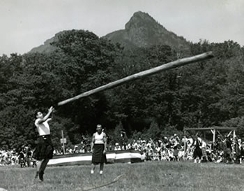 Tossing the caber at the Grandfather Mountain Highland Games. Photograph by Hugh Morton. North Carolina Collection Photographic Archives.