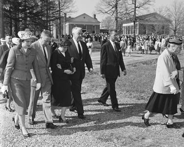 U.S. Senator Sam Ervin and his wife Margaret Bell walk with family members in procession at W. Kerr Scott funeral, April 19, 1958