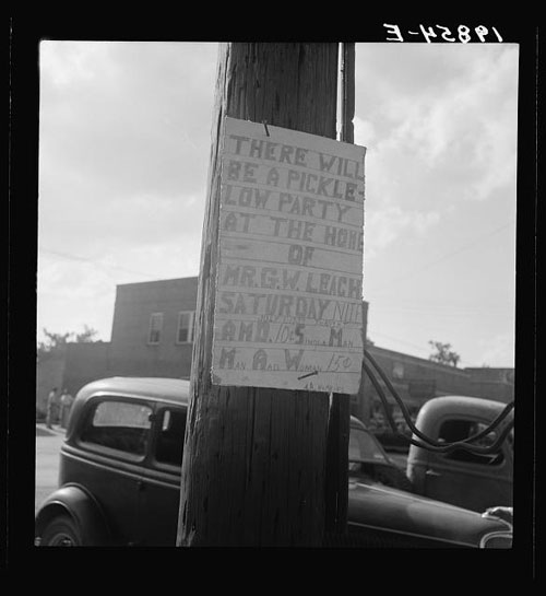 "Photo by Dorothea Lange. ""Sign tacked to pole near the post office. Main street, Pittsboro, North Carolina,"" Dorothea Lange, 1939"