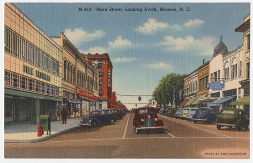 Postcard of Main Street, Monroe, NC, includes Belk store in foreground