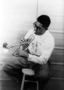1955 portrait of Dizzy Gillespie from the Library of Congress Prints and Photographs Division, Van Vechten Collection, reproduction number LC-USZ62-102156 DLC.