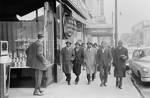 Photographer Jim Thorton's selected negative, which was not published, of Martin Luther King and others as Martin Luther King, Jr. and others walked to Woolworth's.