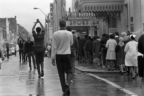 Billy Barnes photo of protestors from behind with their hands in air