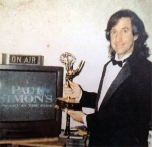 Huntley holding Emmy Award