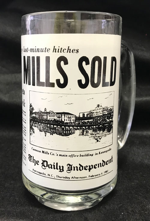 Glass mug with another partial image of Daily Independent story on Cannon Mills sale