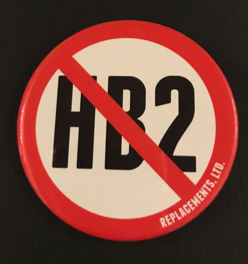 Pinback with Stop HB2 and created by Replacements Ltd.