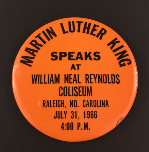 Pinback for Martin Luther King visit to Reynolds Coliseum