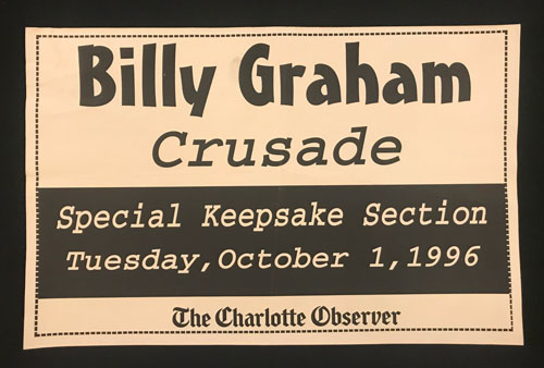 "Newspaper rack card that reads, ""Billy Graham Crusade, Special Keepsake Section, Tuesday, October 1, 1996"