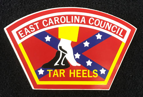 "Sticker with words ""East Carolina Council"" and ""Tar Heel"" and showing a heel pulling away from a patch of tar set against a Confederate flag."