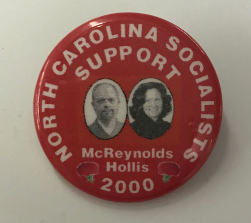 """Pinback reading """"North Carolina Socialists Support McReynolds Hollis"""" and featuring photographs of the candidates."""