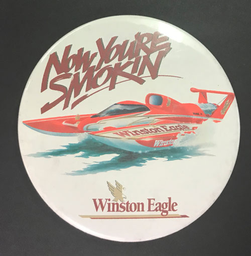 "Pinback featuring illustration of Winston Eagle hydroplane and the line ""Now You're Smokin"""