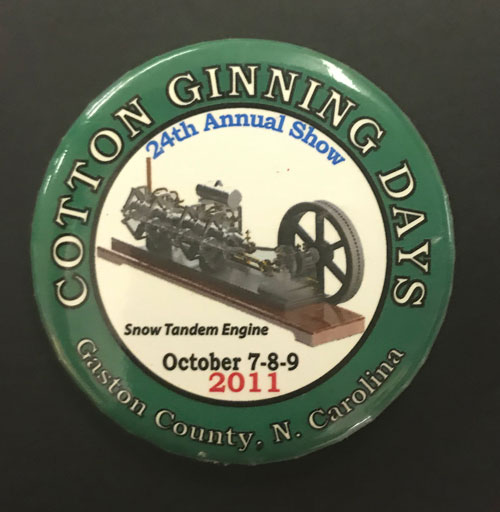 Pinback for Cotton Gining Days 24th Annual show on October 7 through 9, 2011. Pinback features an image of a cotton gin.