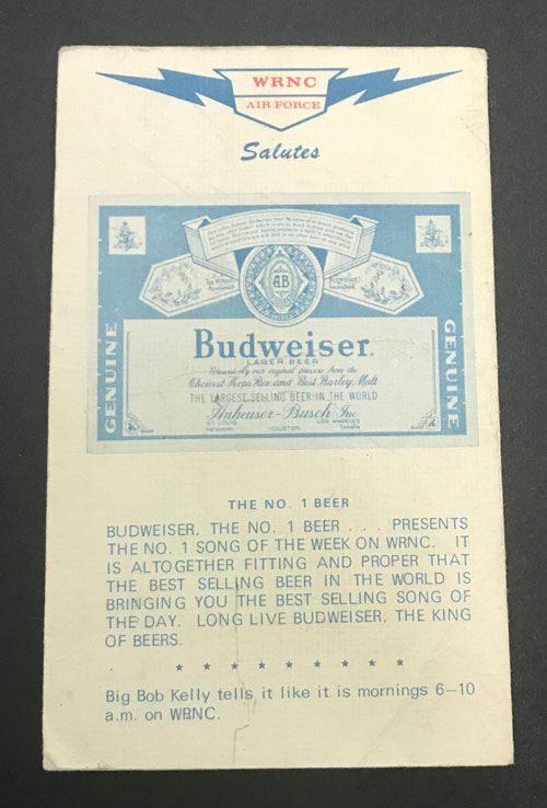 Verso of flyer with WRNC top 50 songs featuring a Budweiser advertisement.