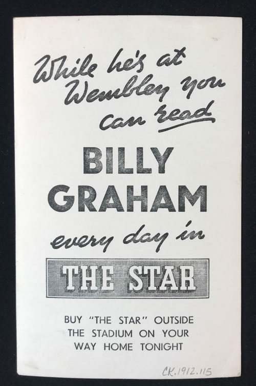 Verso of Billy Graham postcard with text encouraging readers to buy the Star newspaper to read about Billy Graham's crusades at Wembely Stadium.