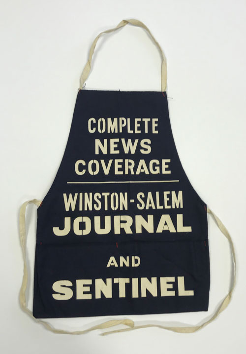 "Apron with words ""Complete News Coverage, Winston-Salem Journal and Sentinel"""