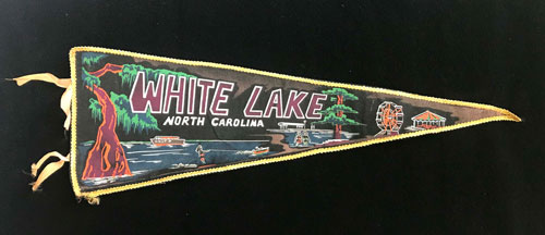 "Pennant that reads ""White Lake, North Carolina,"" and includes images of water, Spanish moss, a boat, and a Ferris wheel."