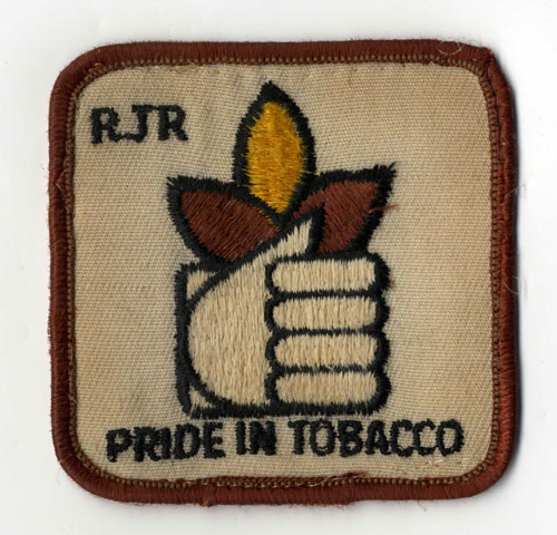 "Patch that reads ""RJR, Pride in Tobacco"" and features a hand holding a tobacco leaf."