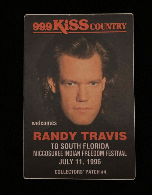 """A sticker with a photograph of Randy Travis and the words, """"ninety-nine point nine KISS country welcomes Randy Travis to South Florida. Miccousukee Indian Freedom Festival. July 11, 1996."""""""