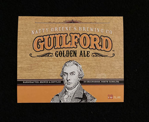 """Beer bottle label with a portrait of Nathaniel Greene and the words """"Natty Greene's Brewing Company. Guilford Golden Ale."""""""