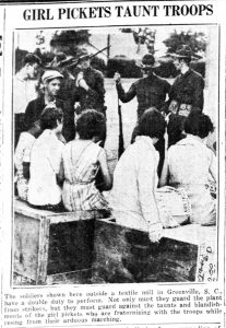 "Newspaper headline ""Girl Pickets Taunt Troops"" and a photo of women and National Guardsmen looking at each other"