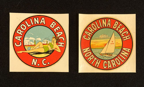 Two decals with words Carolina Beach, NC. One has an image of a woman sunbathing. The other has an image of a sailboat.