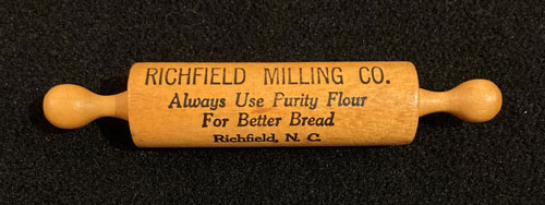 Wooden rolling pin with the words Richfield Milling Company, always use purity flour for better bread. Richfield, NC.