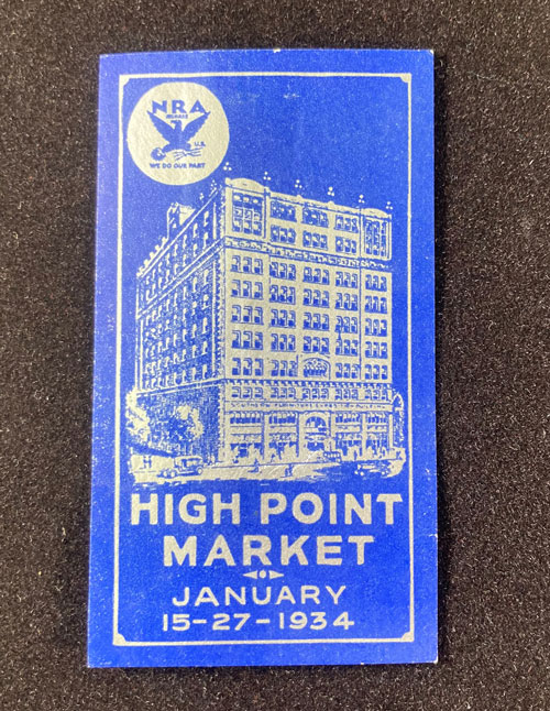 """Blue paper with silver illustration of High Point building and the words """"High Point Market, January 15-27, 1934"""""""