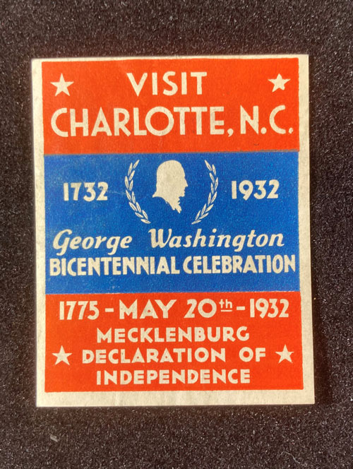 """Paper with the words """"Visit Charlotte, NC,"""" """"1732-1932, George Washington Bicentennial Celebration,"""" and """"May 20, 1775, 1932, Mecklenburg Declaration of Independence."""""""