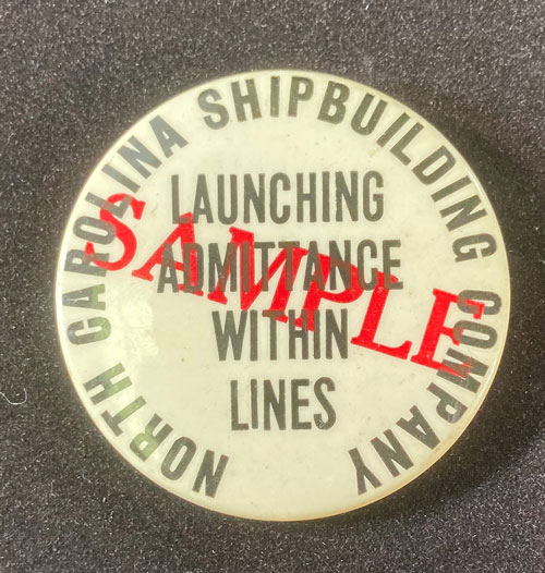 """Pinback that reads """"North Carolina Shipbuilding Company, Launching Admittance Within Lines"""""""