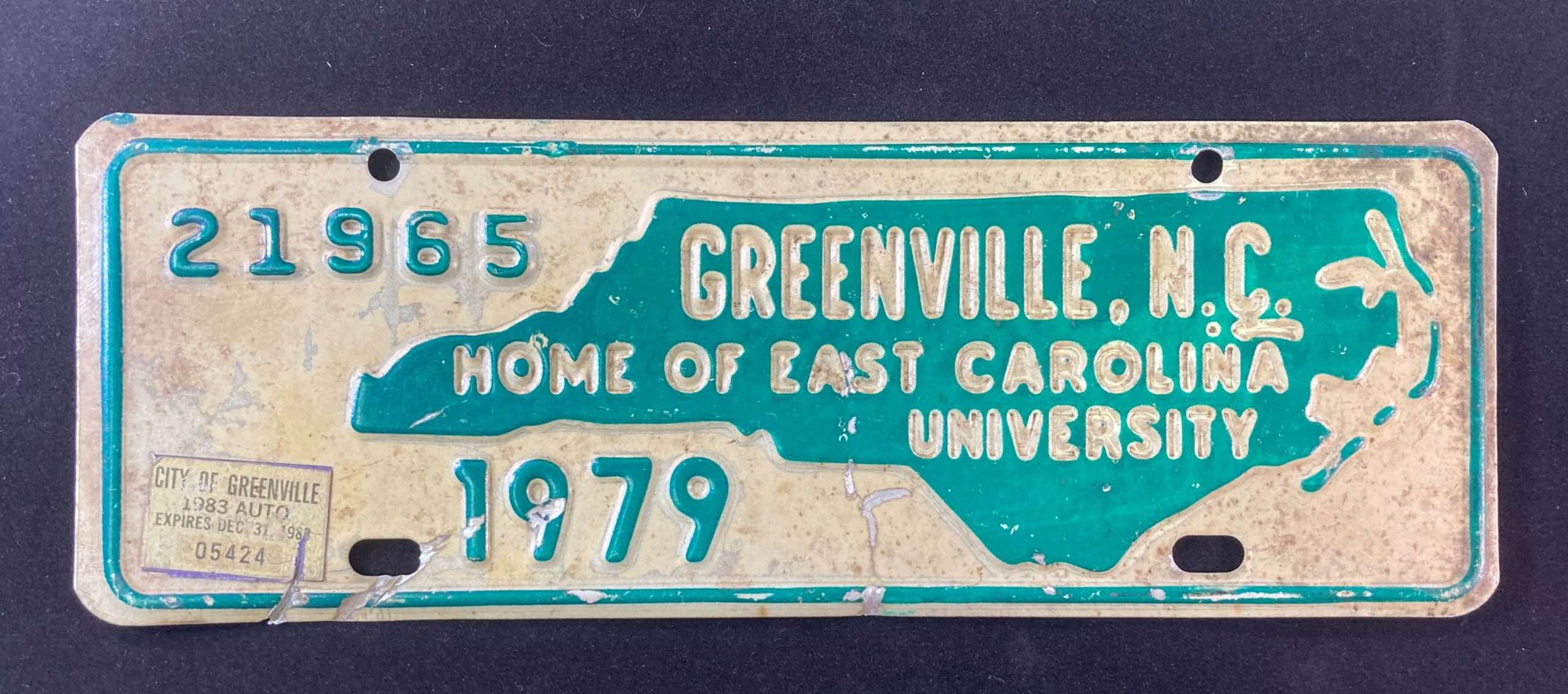 """Front license plate with a map of North Carolina and the words """"Greenville, NC, Home of East Carolina University, 1979"""""""