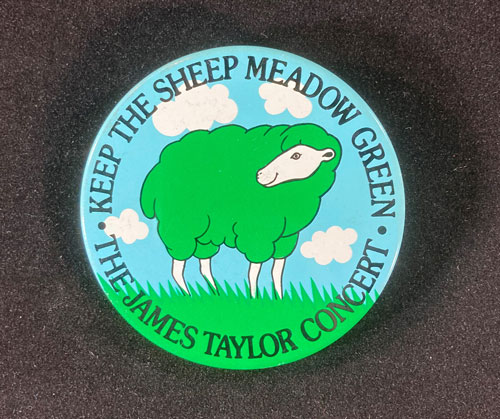 """Pinback button with image of a sheep with green wool and the words """"Keep the Sheep Meadow Green, The James Taylor Concert.'"""