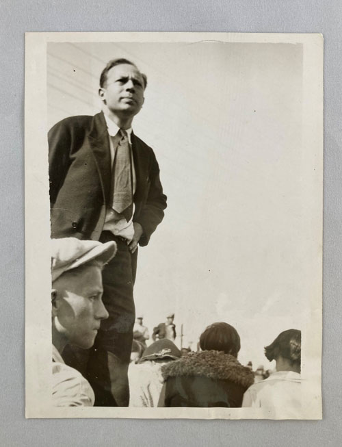 Photograph of man speaking to crowd