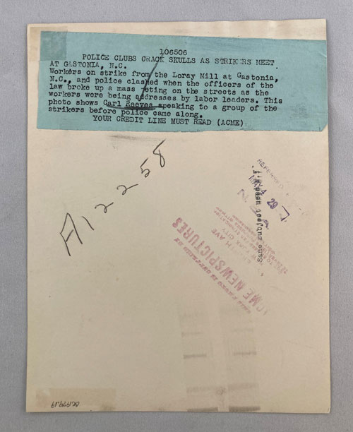 Text on rear of image noting that speaker in photo is Carl Reeves.
