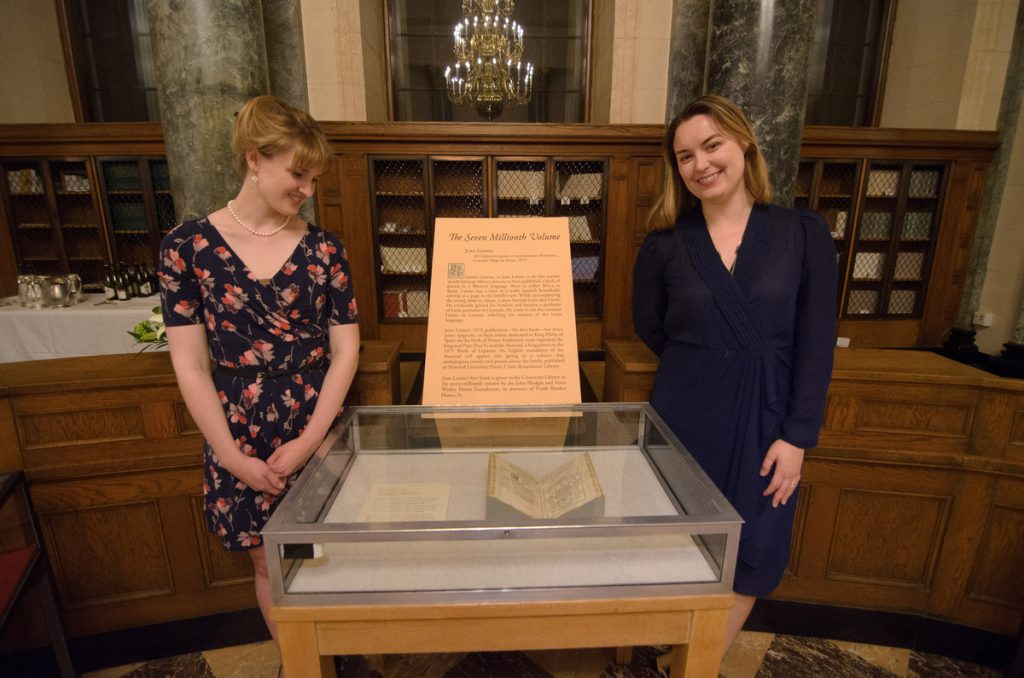 Daphne Bissette and Alia Wegner of the Rare Book Collection with Juan Latino's book