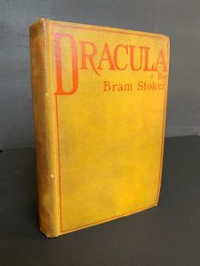 First edition of Dracula, bound in yellow buckram with red title and border