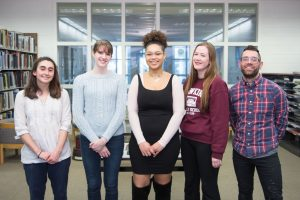 The 2017 Incubator Award recipients, standing in a horizontal line inside a library. From left to right, the students are Ayla Gizlice, Anne Bennett, Karly Smith, Margaret Maurer, and Joel Hopler. Recipient Emily Yue is not pictured.