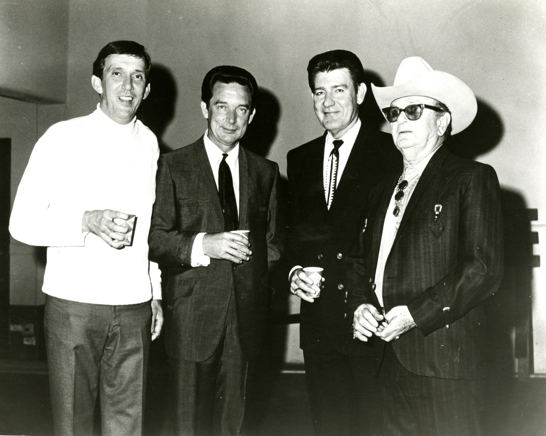 P3910_Standing from left to right: KBBQ disc jockey Hugh Jarrett, musicians Ray Price and Tex Williams, and tailor Nudie Cohn. The four are backstage at the KBBQ First Anniversary Show_Southern Folklife Collection Radio and Television Files (30015)