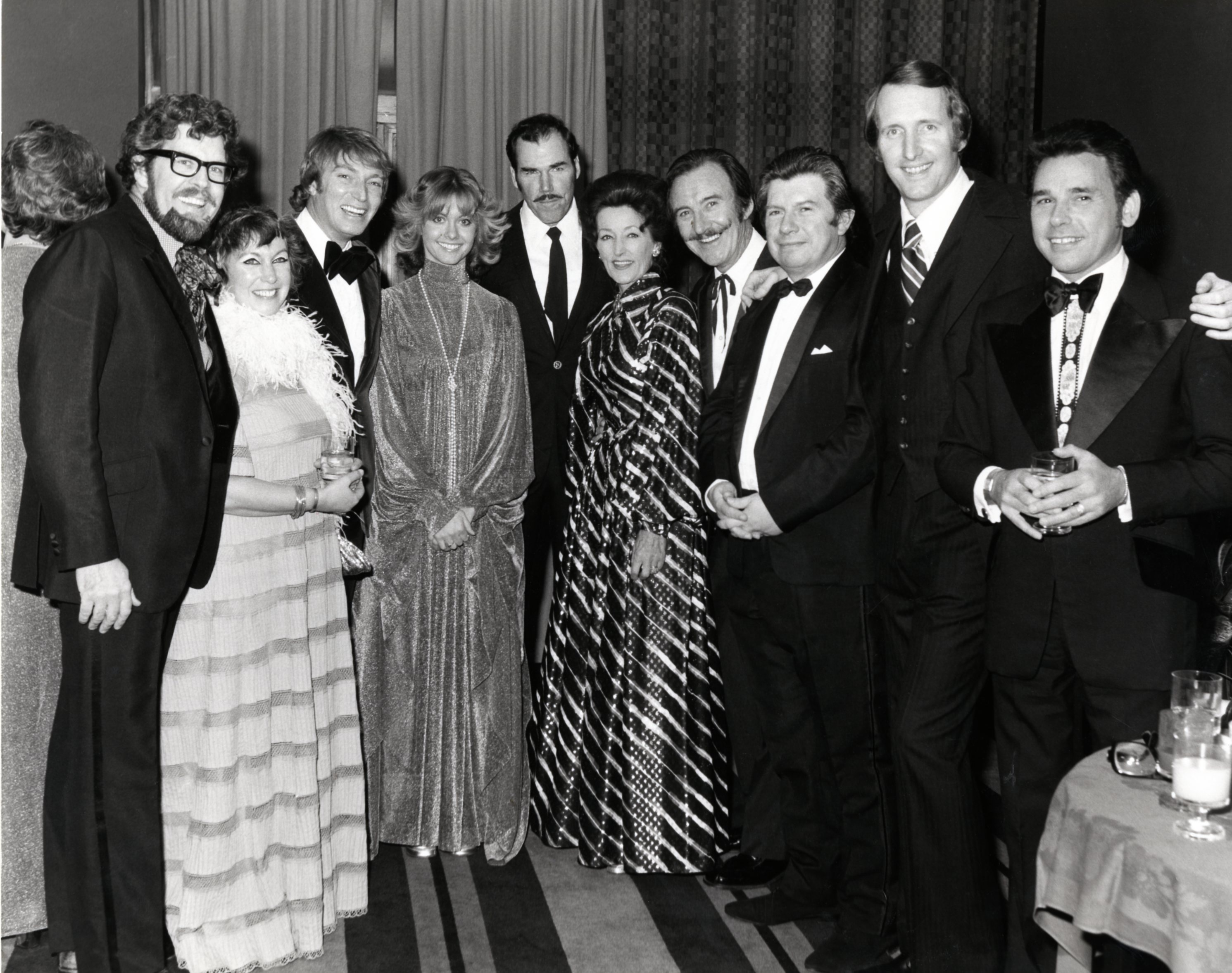George Hamilton IV, Rolf Harris, an unidentified woman, Frank Ifield, Olivia Newton-John, Slim Whitman, Miki & Griff, an unidentified man, and Mervyn Conn, at Wembley, 1974, b&w print, roughly 8x10, photo by Dominic McKenzie, P4920 in the George Hamilton IV Collection (20410), Southern Folklife Collection, UNC Chapel Hill