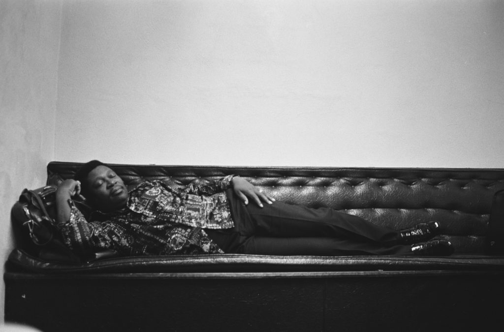 BB King lying on a couch asleep before a show