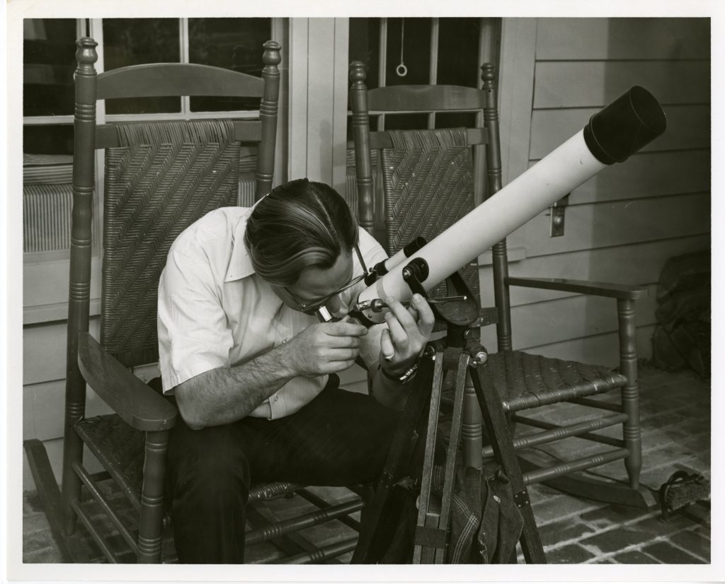 with a telescope P-20418/2_John D. Loudermilk in his studio, Southern Folklife Collection_UNC Chapel Hill