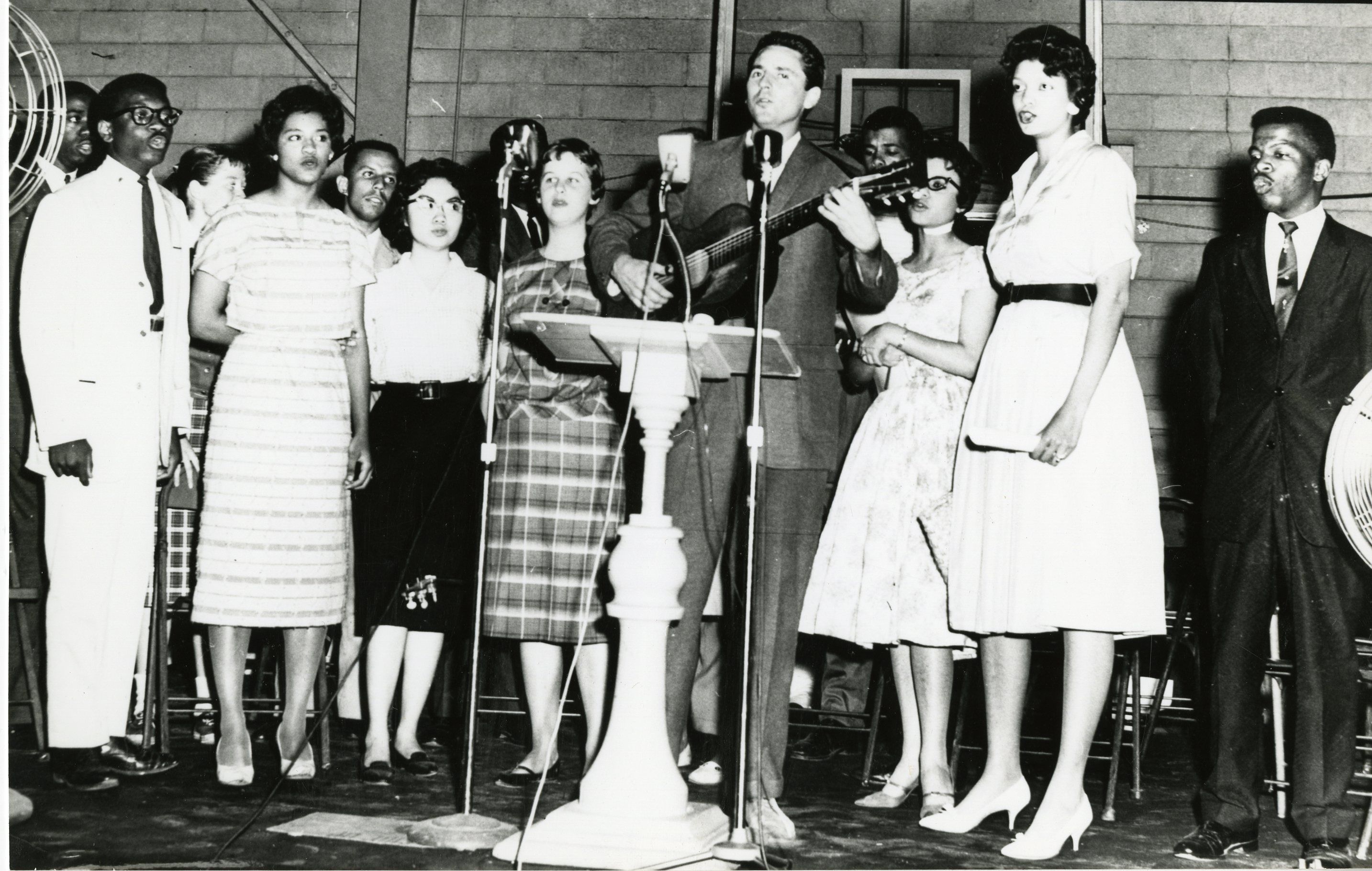 Members of SNCC singing onstage at FIsk University, 1960, including Guy Carawan, Candie Carawan, and John Lewis, amongst others. PF20008_0058_0006_002. Guy and Candie Carawan Collection (20008).
