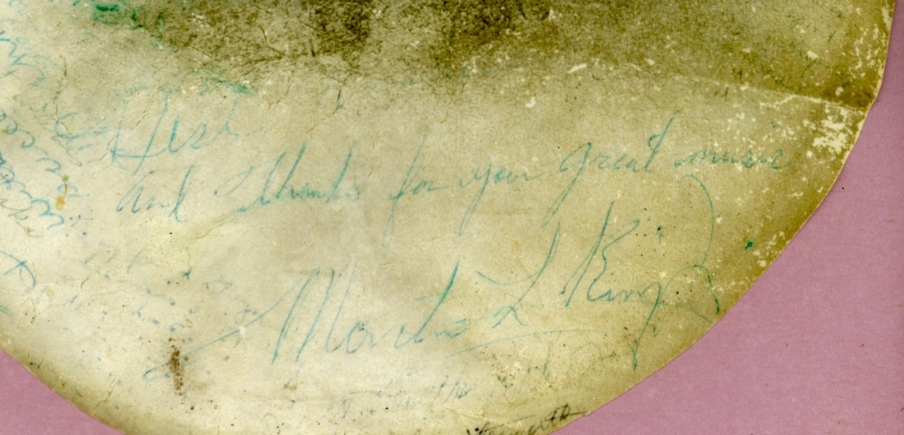 closeup of Martin Luther King, Jr. signature on Guy Carawan's banjo head