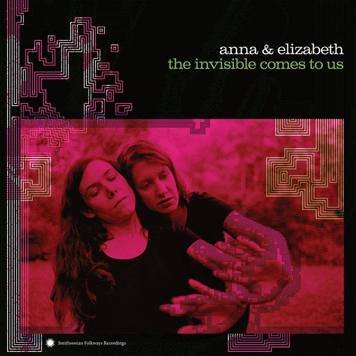 "cover of 2018 LP by Anna & Elizabeth, ""The Invisible Comes to Us"". Photo of the two artists leaning on each other with square designs superimposed."