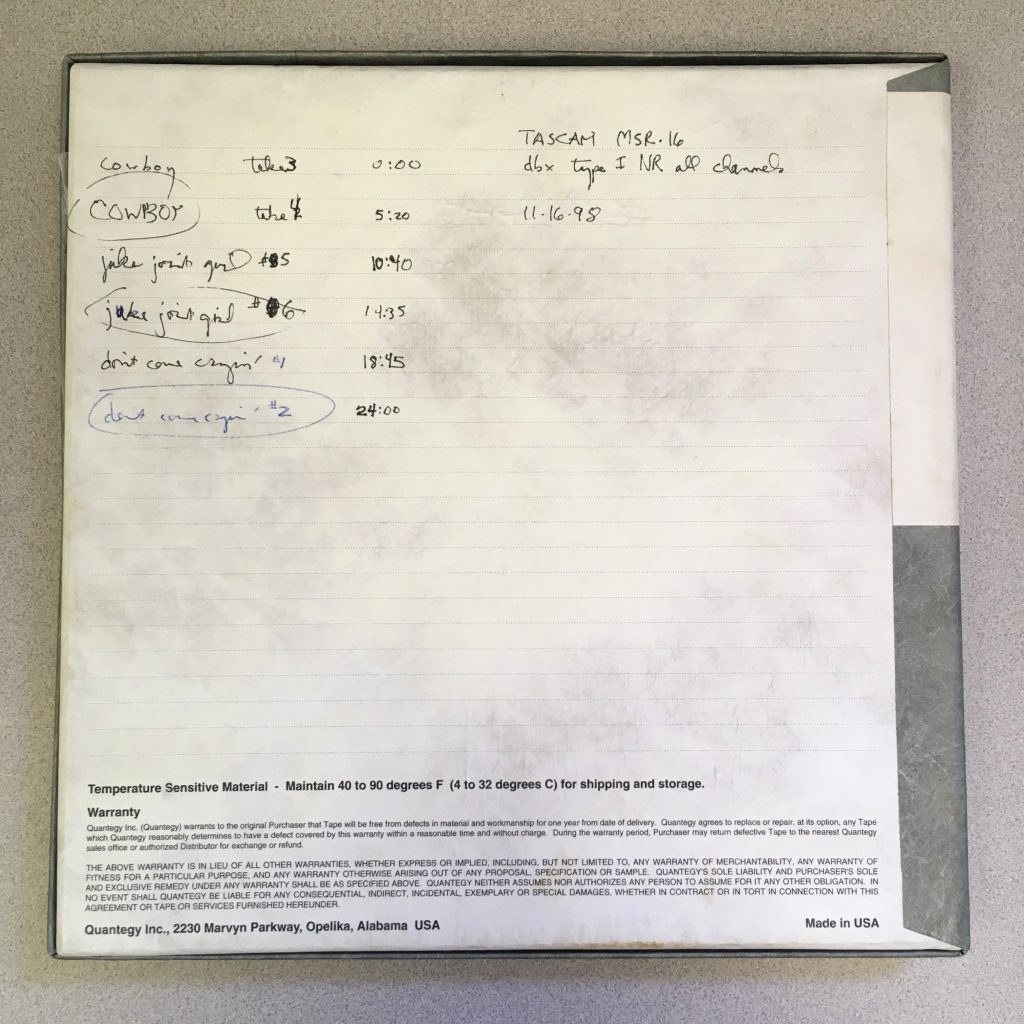 The back of an open reel tape box featuring a handwritten track listing of songs by Tift Merritt and the Carbines.