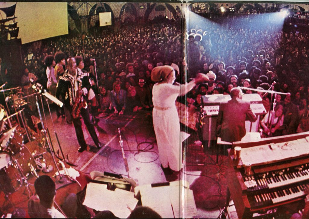 Inside gatefold of LP with photo of Aretha Franklin and band performing onstage, photo taken from behind the band looking at the audience.