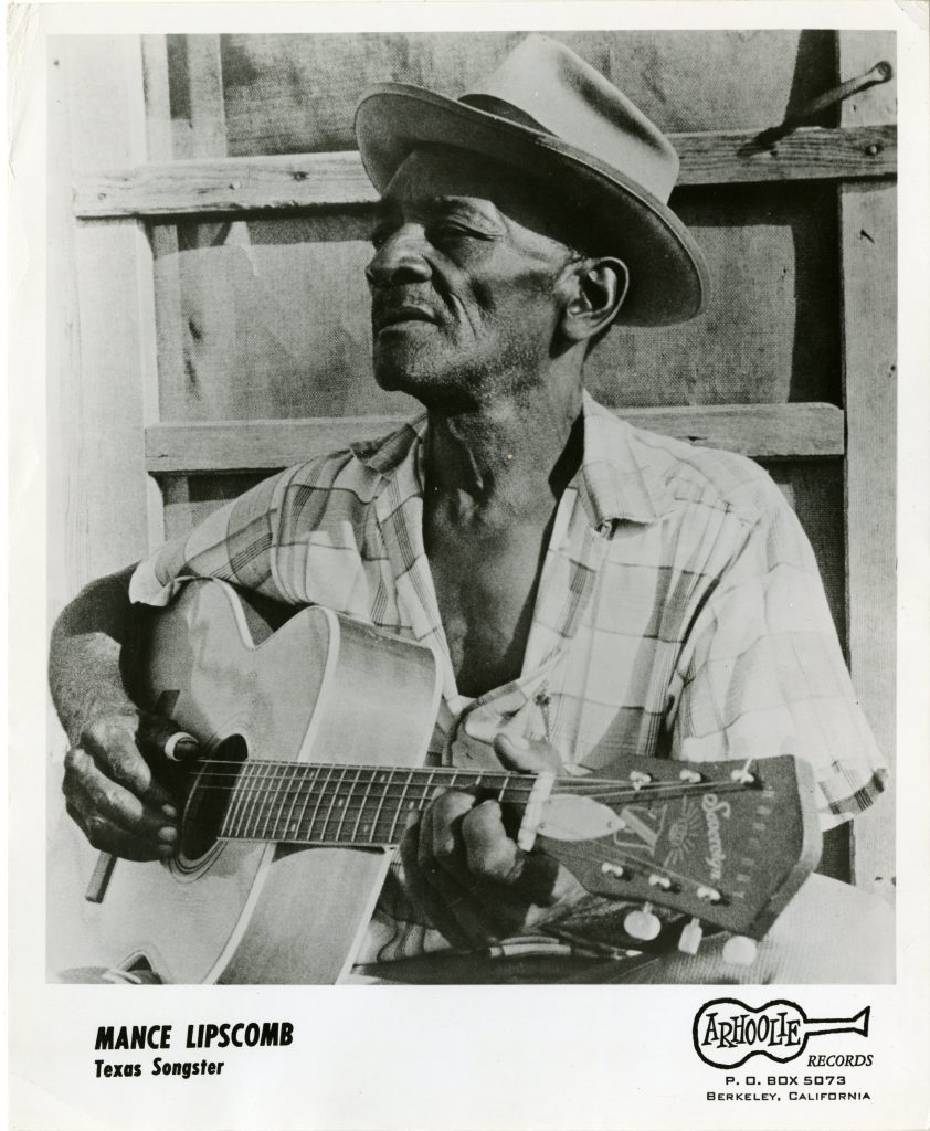 same black and white photo of Mance Lipscomb from album cover, holding guitar