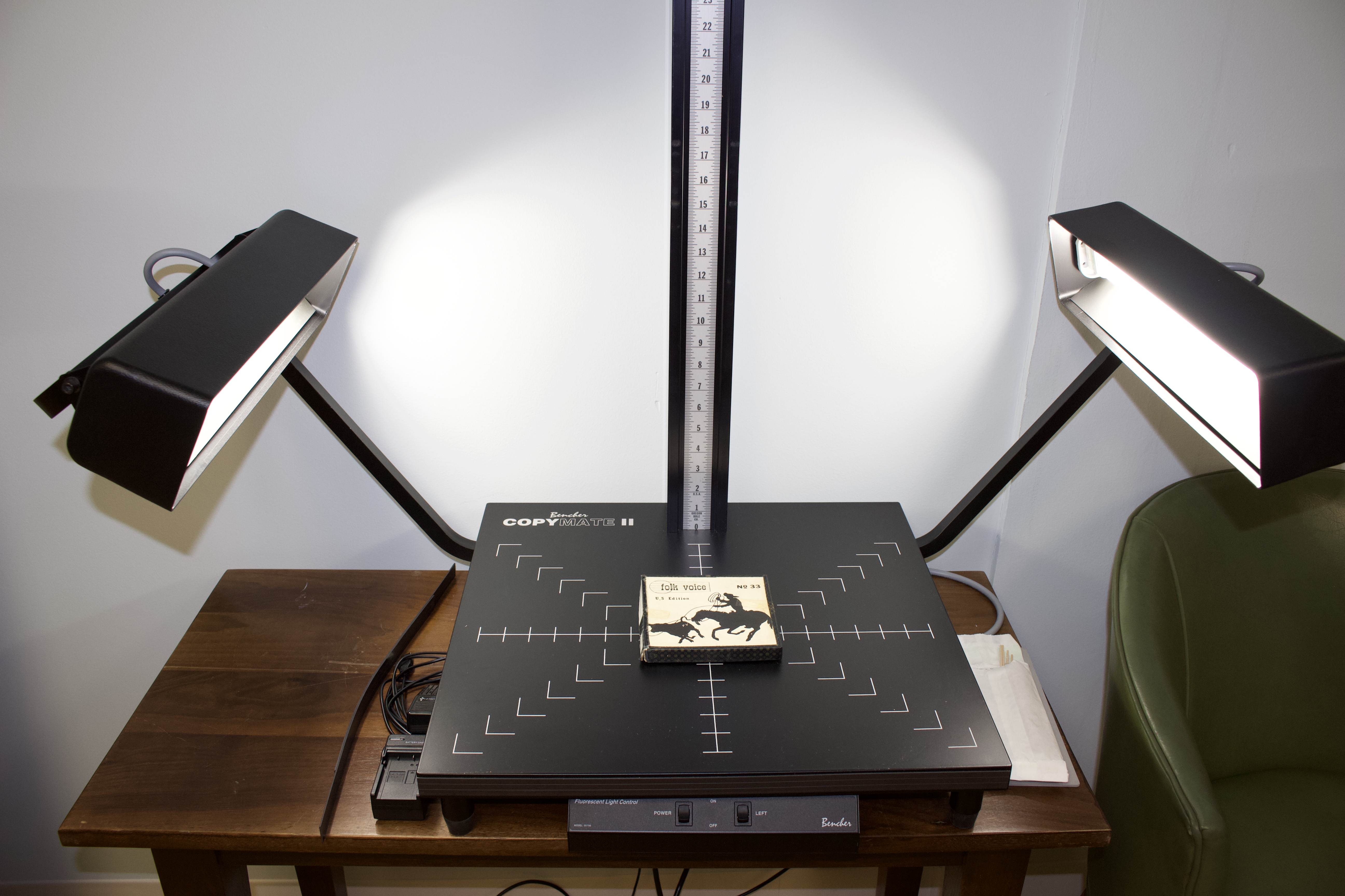 a photo stand with two lights projected onto an audiotape box