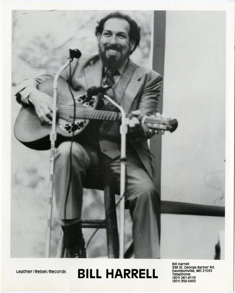 Bill Harrell with guitar on stage, promotional photo